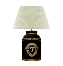 Lampa i plåt med målad 7:a i guld på svart botten