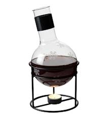 Glöggkolv i glas samt värmehållare i smidesjärn