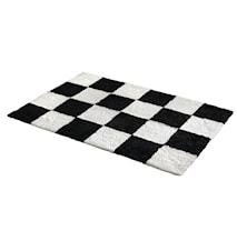 Chess Ternet fåreskindstæppe 120x180 - Black Offwhite