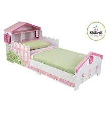 Barnsäng med dockhus